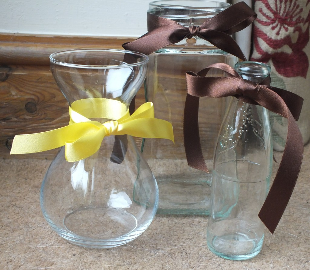 Ribbon on jars for wedding flowers