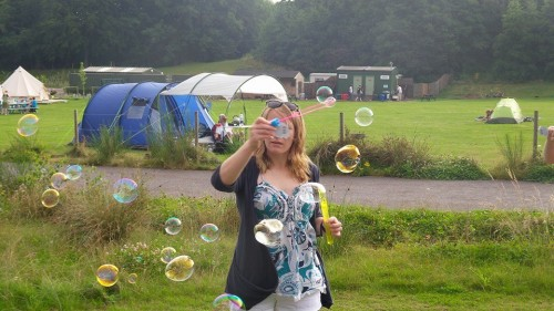 Blowing bubbles whilst glamping at Whitlingham