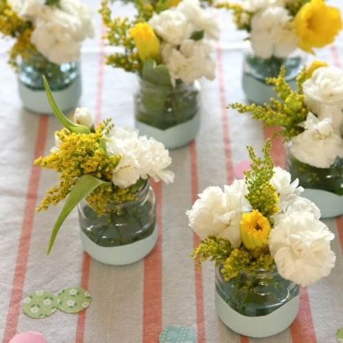 Yellow and white flowers in jars