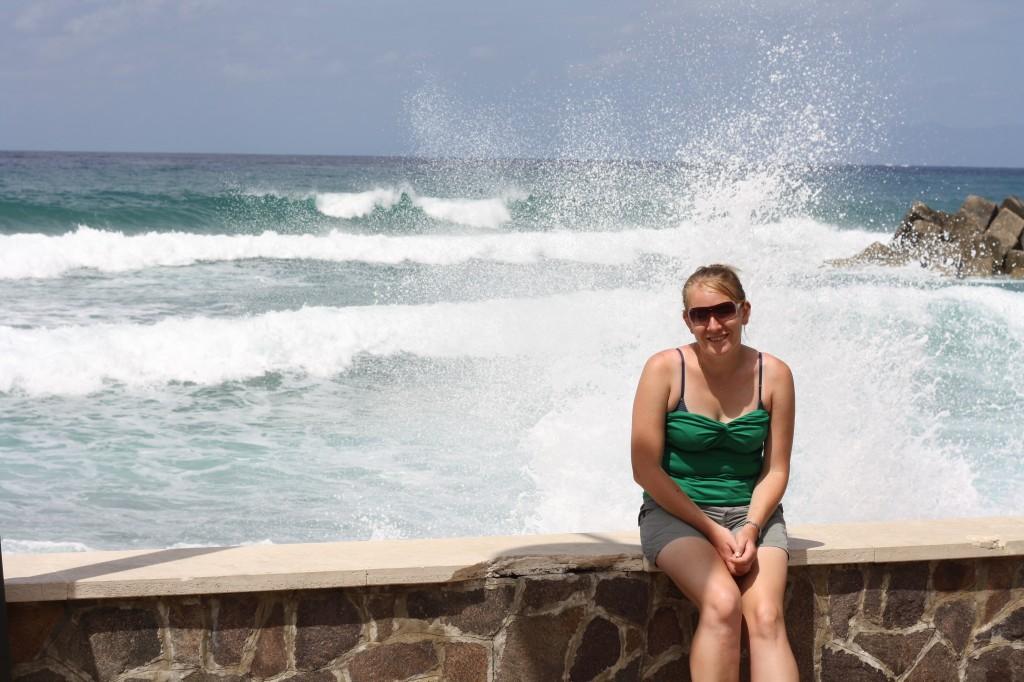 Me sat on the rocks in Italy on honeymoon