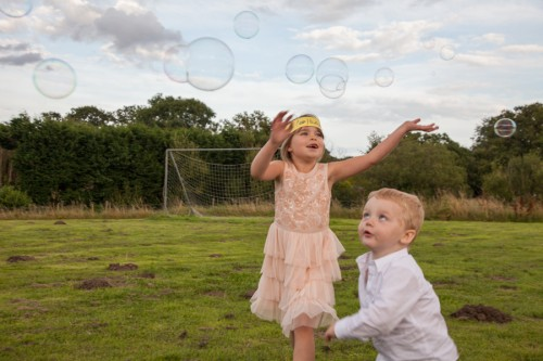 Kids with the bubble wand at our wedding