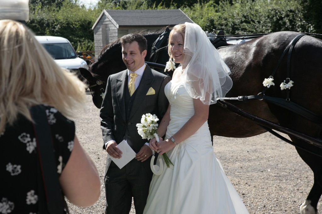 Dan and Me on our wedding day in front of the horse and carriage