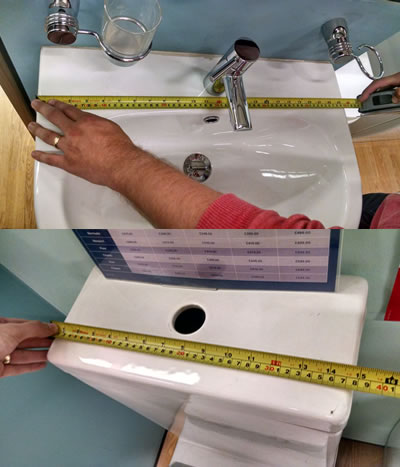 Measuring up the sink and toilet for the new bathroom