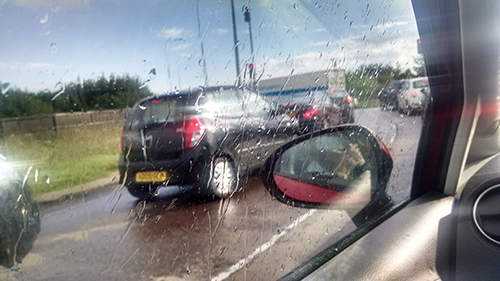 Queuing in the rain whilst stuck in traffic