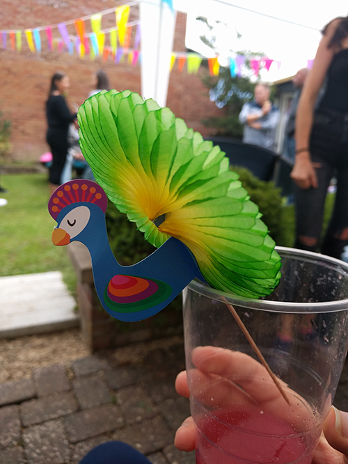 Cocktail umbrella in the shape of a peacock