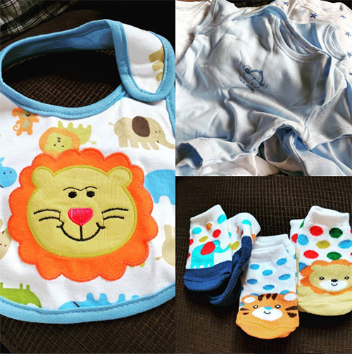 Blue baby clothes, bibs and socks