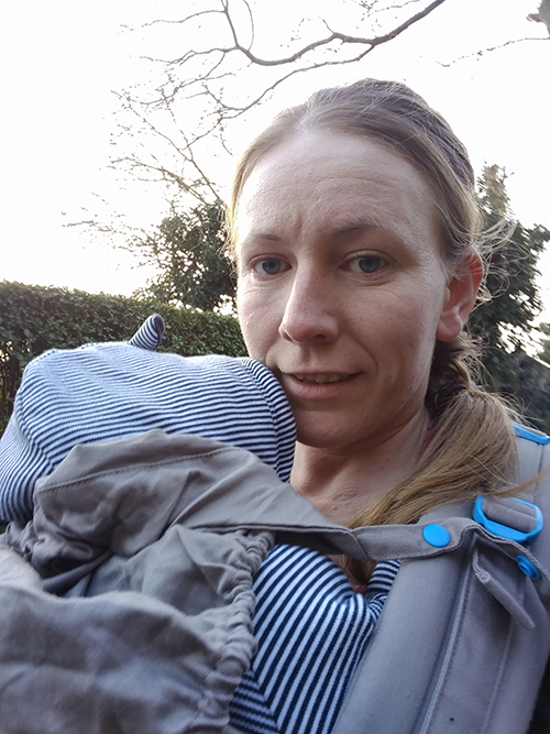 Walking with Oscar in the baby carrier