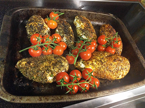 Chicken with tomato on the vine
