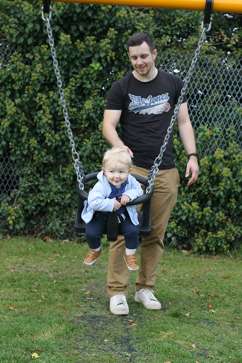Oscar and Dan on the swings