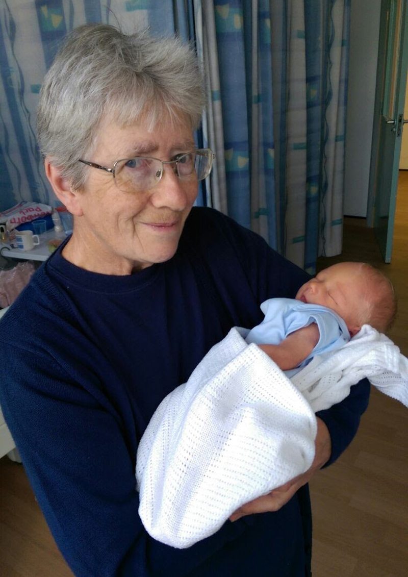 Mum meeting Oscar for the first time