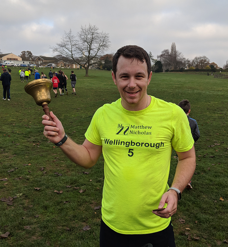 Dan ringing the parkrun PB bell