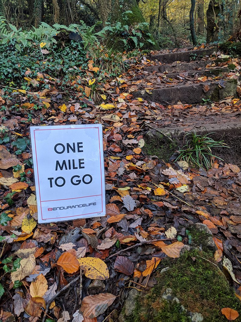 One mile to go sign at the EnduranceLife Gower Marathon