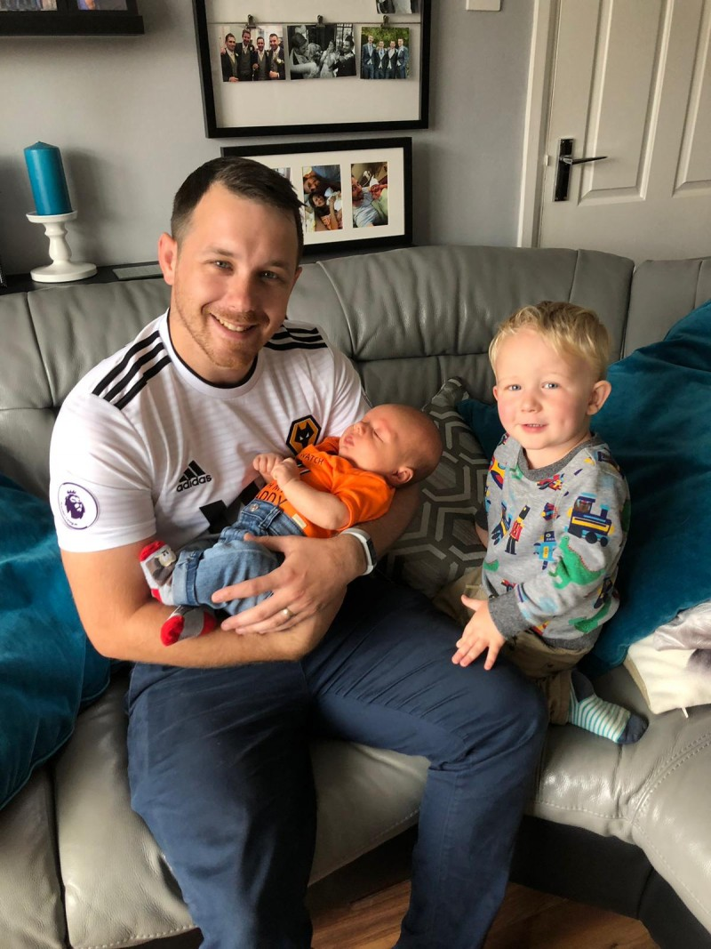 Dan and Oscar meeting baby Grayson
