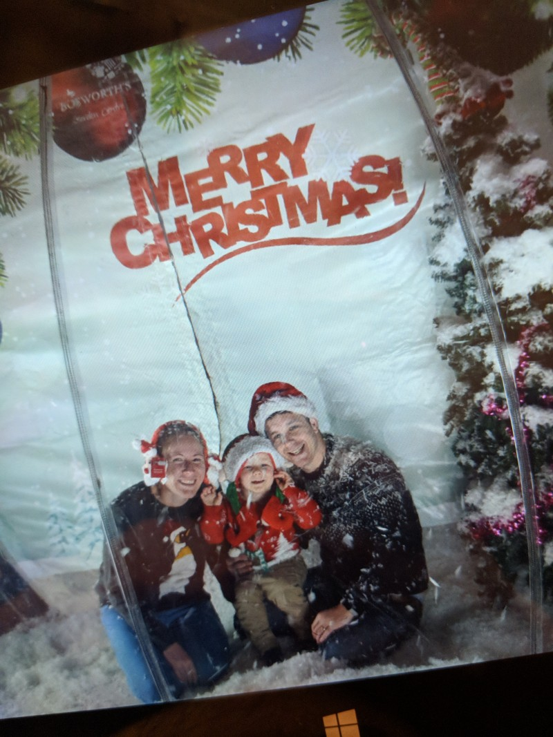 Oscar, Dan and I having our photo taken inside a snow globe